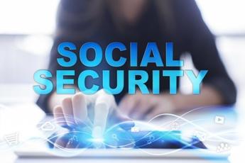Woman Using a Social Security Touchscreen