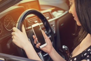 New Mexico Teen Using Cell Phone While Driving