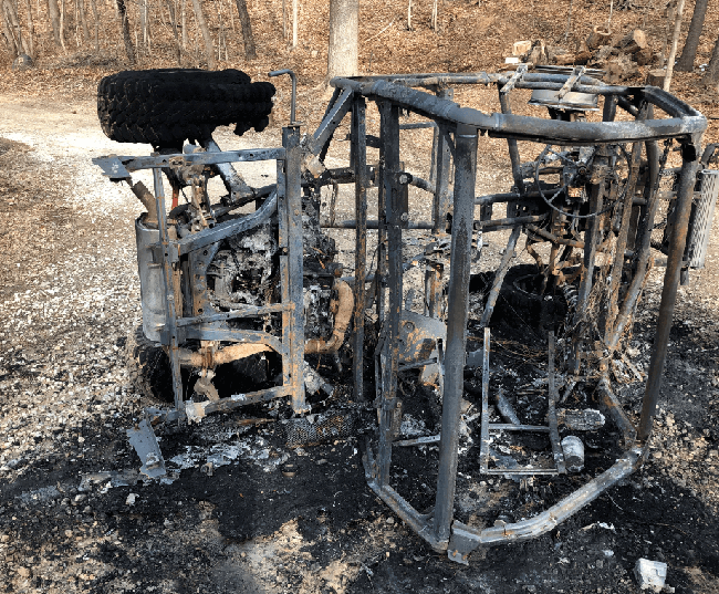 The burnt chassis of a Polaris RZR.