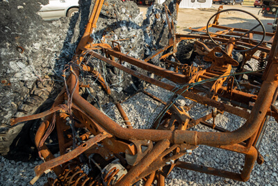 The charred wrecked of a Polaris RZR.