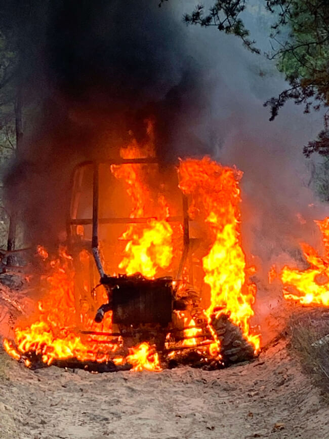 A burning Polaris RZR