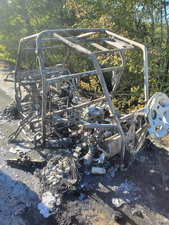 The rear view of the burnt remains of a Polaris RZR, taken in Maine.
