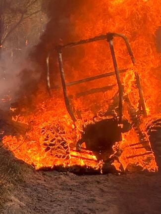 A Polaris RZR Turbo 1000 engulfed in flames.
