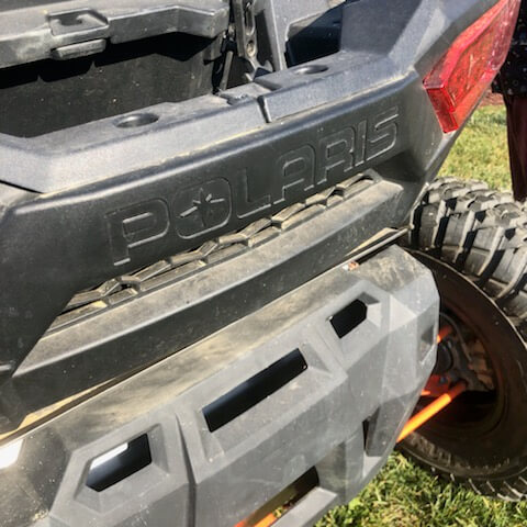 The Polaris logo on the rear of one of their RZR side by side off road vehicles.