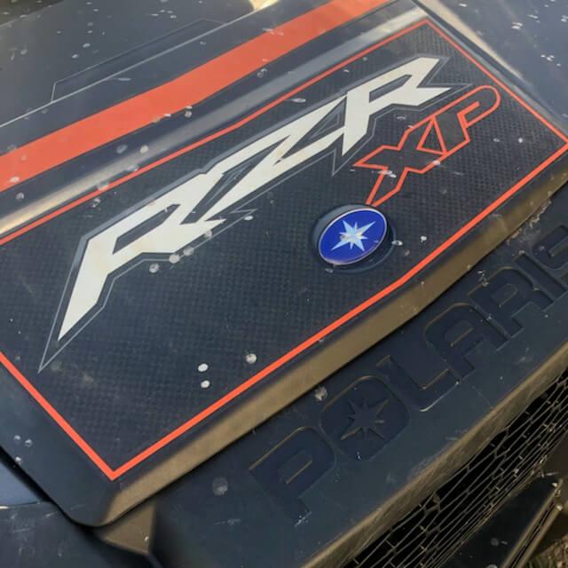 Polaris' RZR XP logo, as seen on one of their vehicles.