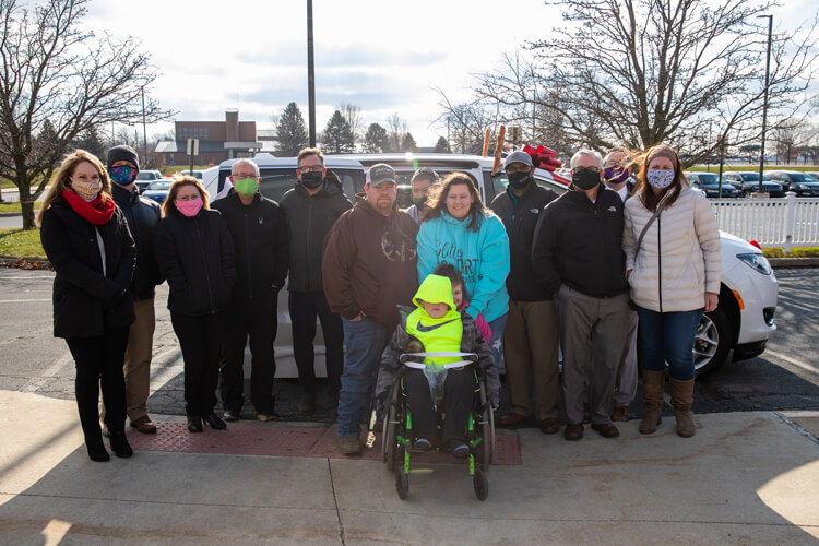 Recipients of a new accessible van provided by Samantha's House.