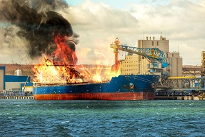 A cargo ship on fire while in port
