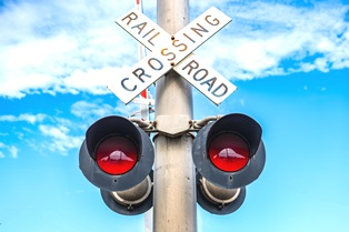 danger of large truck crashes at railroad crossings