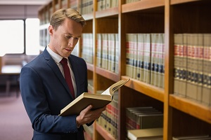 An attorney consults the law library in order to support his client's case