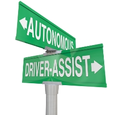 road signs pointing to autonomous and driver assist directions