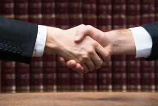 An Attorney Shaking a Client's Hand