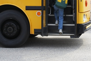A Small Child Getting on a School Bus in Virginia