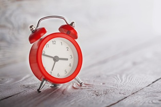 Red Clock Representing a Continuance in a Reckless Driving Case in Virginia