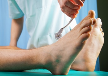 Doctor Testing the Feeling in a Foot