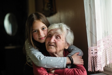 Elderly Woman With a Young Child