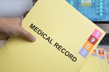 Insurance Agent Holding a Medical Records Folder
