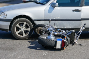 Motorcycle Wreck With a Small Car