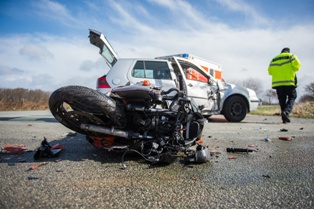 Motorcycle Wreck Scene After a Collision With a Car