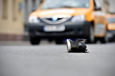 Pedestrian's Shoe in the Road After an Accident With a Car