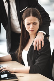 Woman Experiencing Sexual Harassment in the Workplace