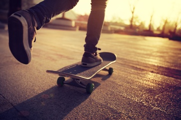 Teenager Skateboarding on the Road