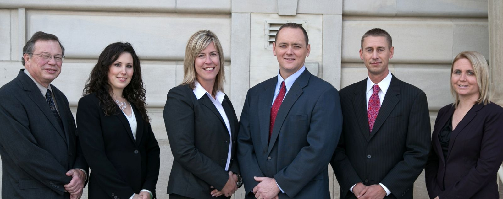 Walker, Billingsley & Bair Legal Team in front of the courthouse