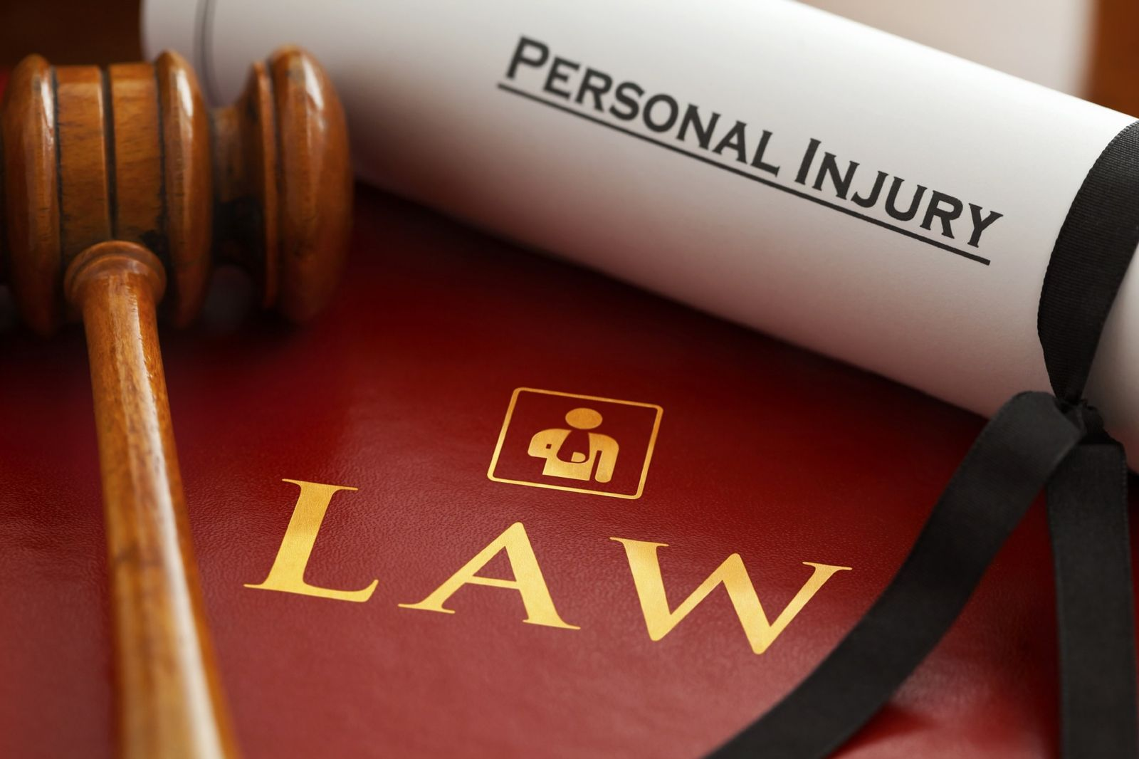 personal injury lawyer book and gavel