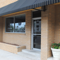 walker, billingsley & bair law office entrance in marshalltown iowa with a black striped awning