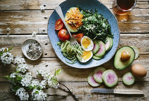 Healthy meal with egg avocado kale and other veggies