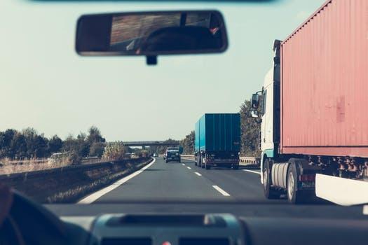 Semi truck merging in front of car