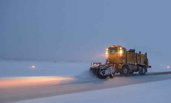 yellow Snow plow at night in iowa