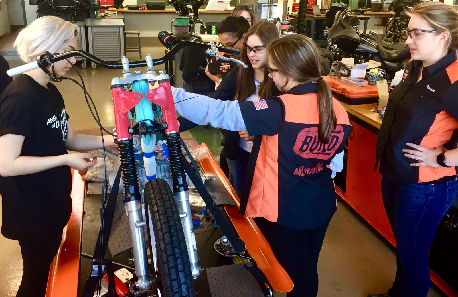 BUILD programs tudents with their flat track bike