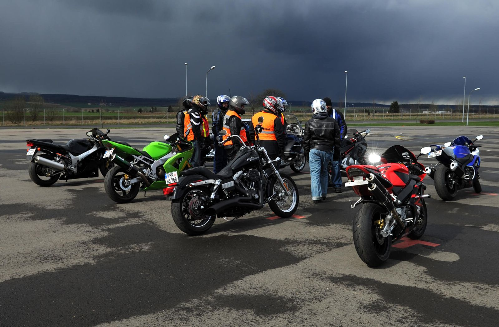 Riders practicing and learning about how to safely ride motorcycles in rain
