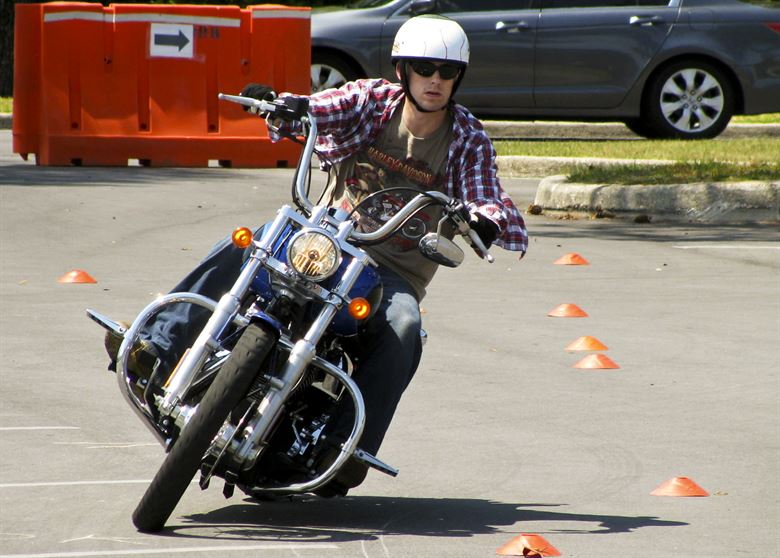 Motorcycle rider practicing swerving in a straight line emergency maneuver