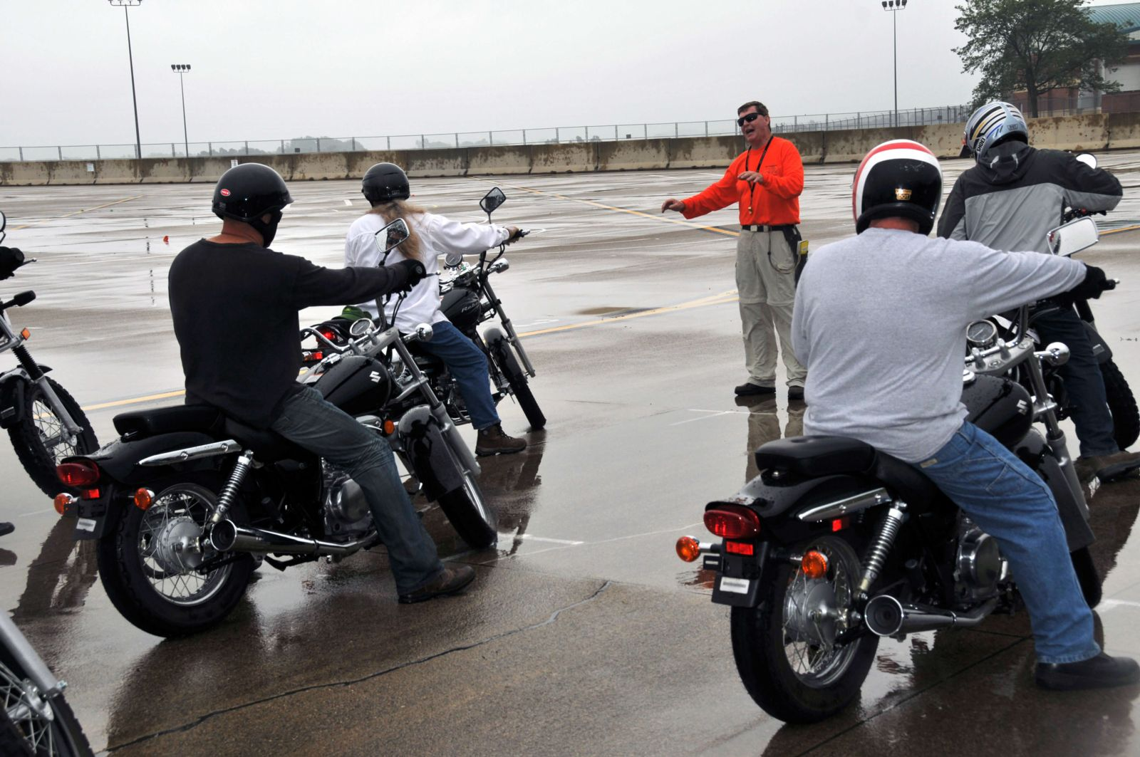 Motorcycle riders performing Obstacle Cross maneuver in motorcycle safety course