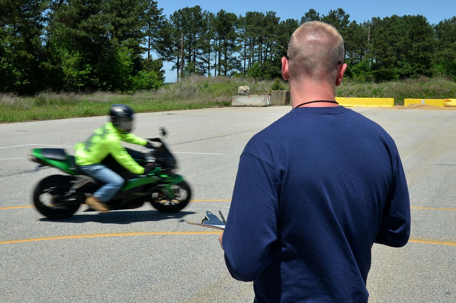 Motorcycle rider practicing Emergency Braking in a Corner