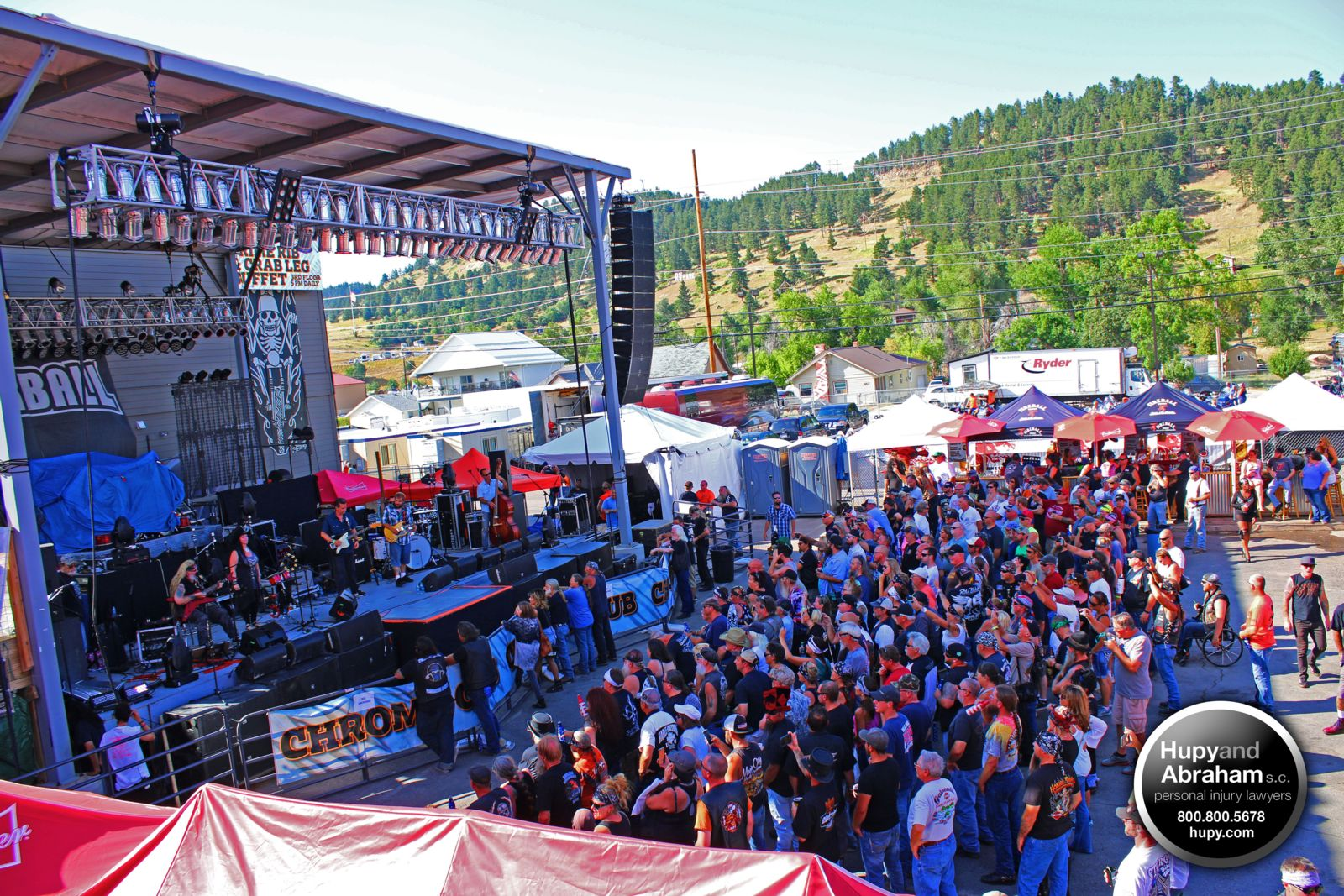Large crowd of people standing in front of event stage at Sturgis Motorcycle Rally