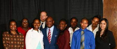 Famed Attorney Willie Gary and Attorney Michael F. Hupy with students at the Wisconsin Association of African-American Lawyers Scholarship Dinner in Milwaukee