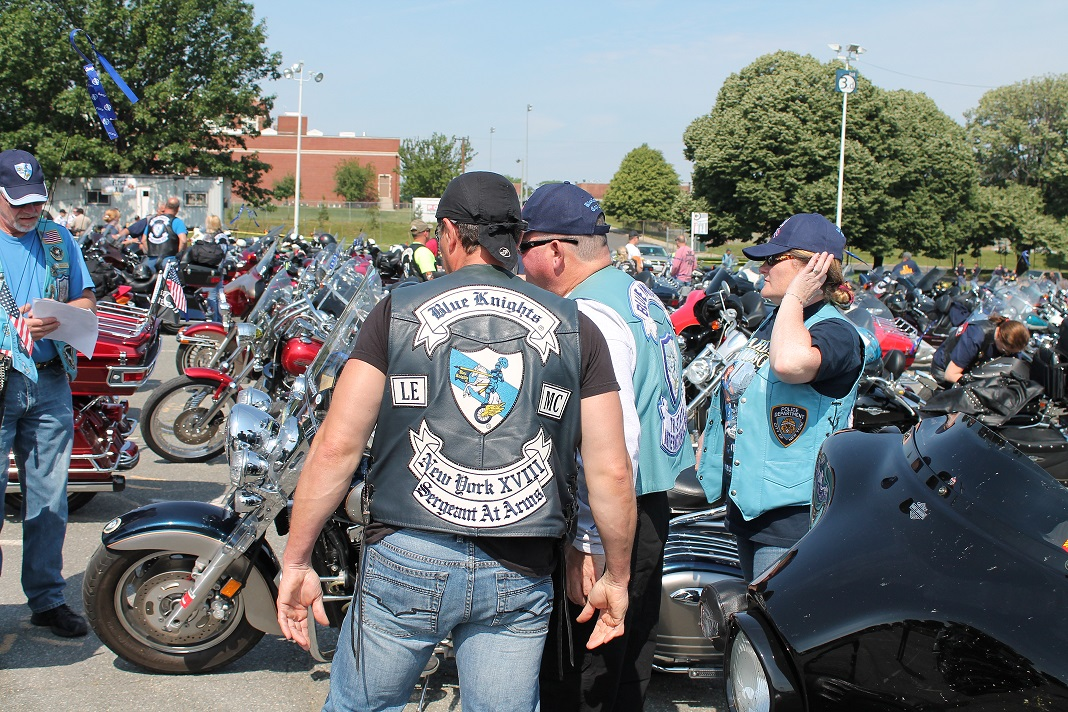 Motorcycle club event with crowds of people and motorcycles