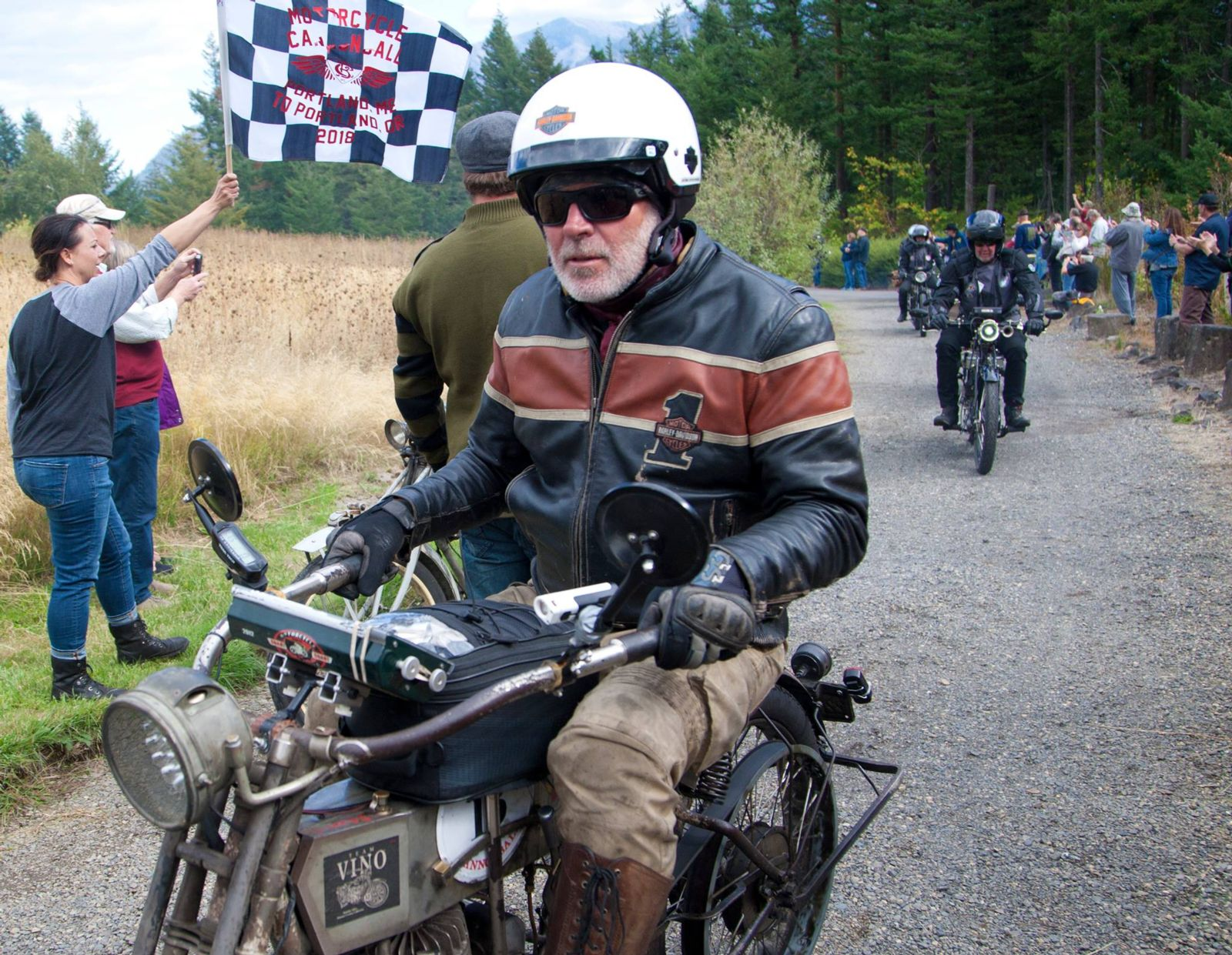 Winner of the 2018 Motorcycle Cannonball, Dean Bordigioni at the checkered flag