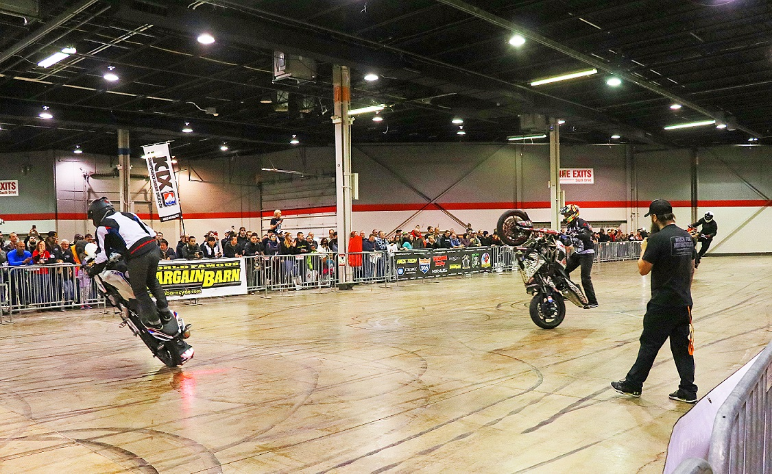 Motorcycle stunt riders at IMS Chicago event