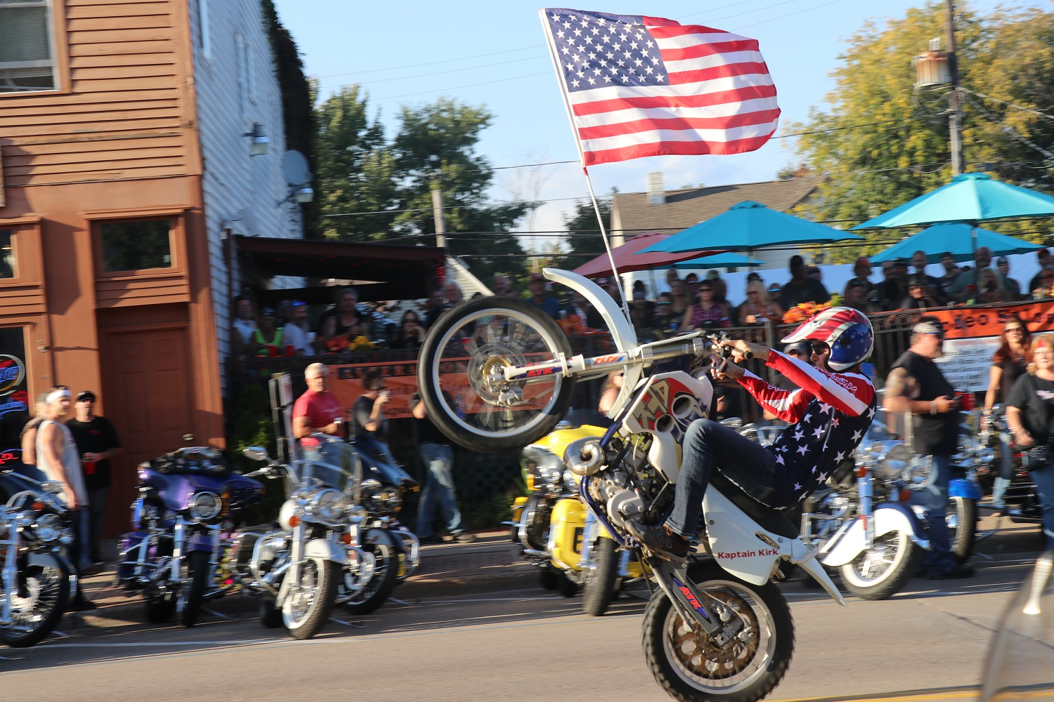 Motorcycle doing wheelie during 37th Annual Tomahawk Fall Ride and Rally