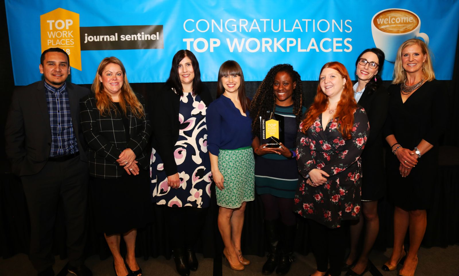 Hupy and Abraham staff with Top Workplace Recognition