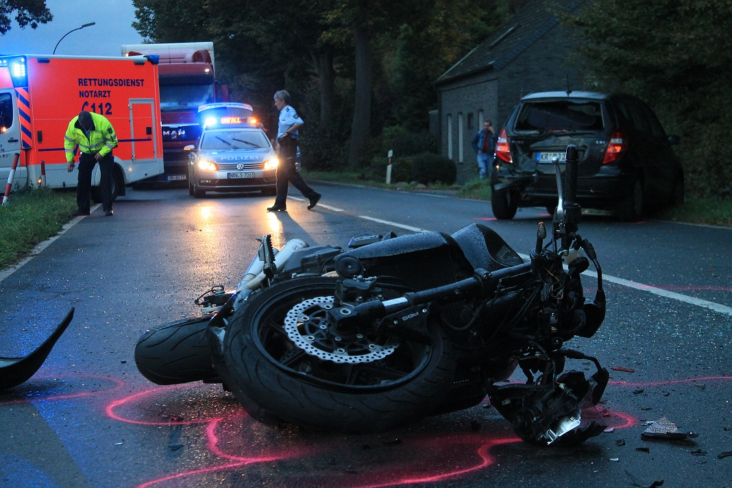 Motorcycle that has been layed down in the street in an accident