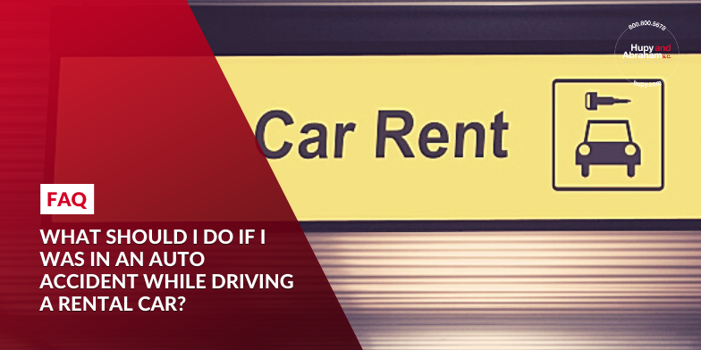 What should I do if I was in an auto accident while driving a rental car?
