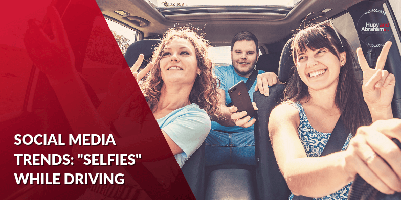 Three people taking selfies while driving in a car