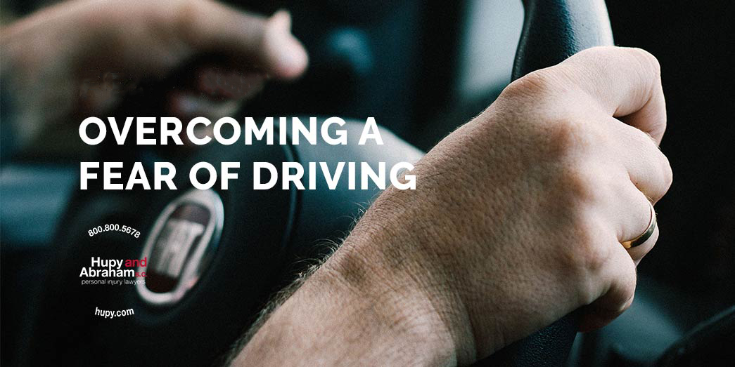 Mans hands on steering wheel of car