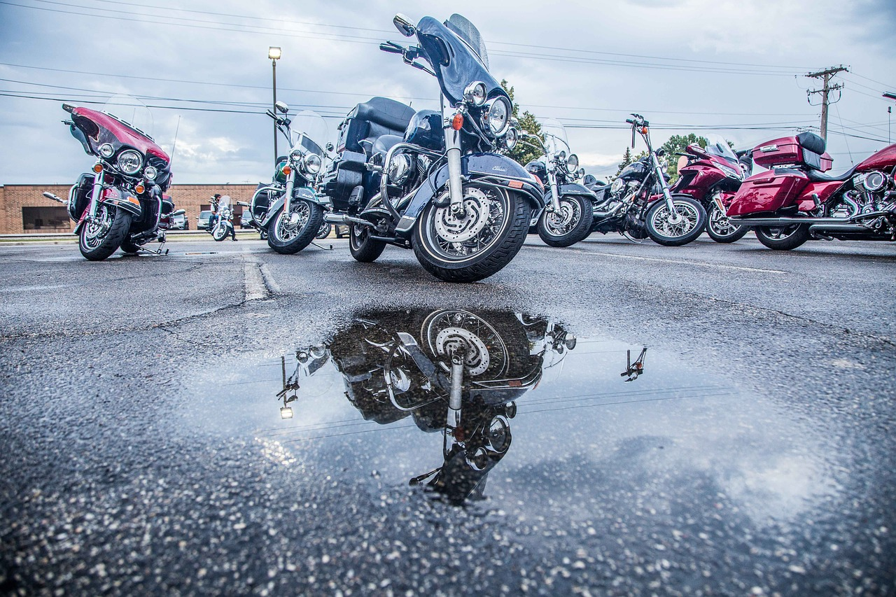 Motorcycles in parking lot with water puddles