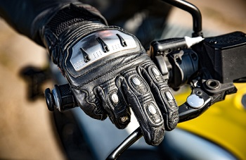 Hand on motorcycle brake to avoid accident