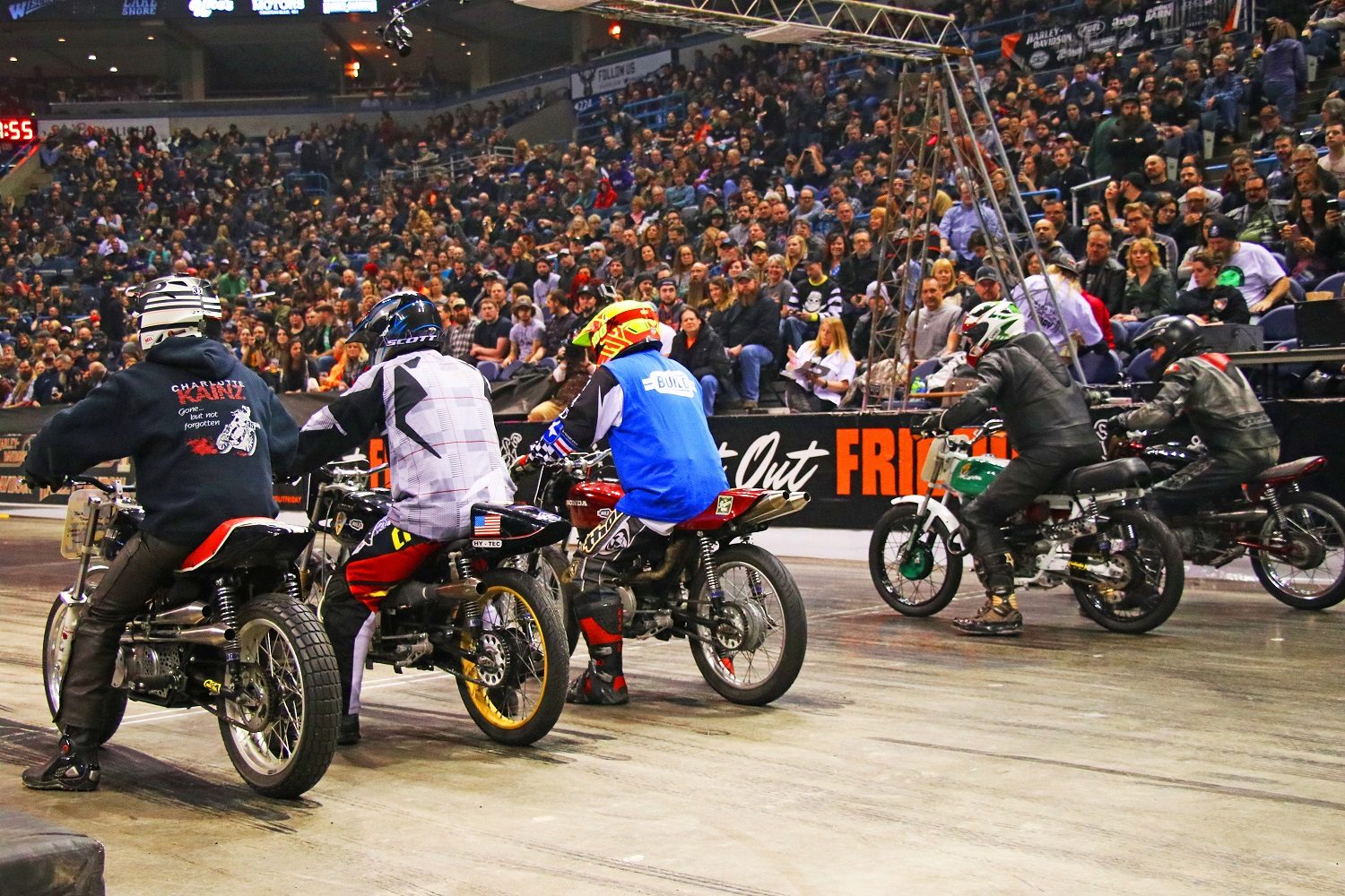 Racers on the track at Mama Tried with hundreds of spectators